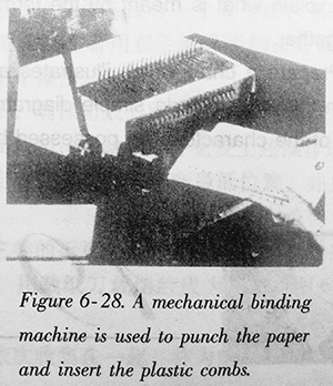 A mechanical binding machine is used to punch the paper and insert the plastic combs